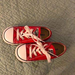 Red converse tennis shoes